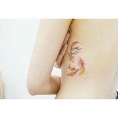 Subtle koi fishes. South Korean tattooist Banul