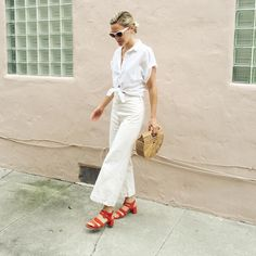 30 Perfect Looks To Copy This June #refinery29  http://www.refinery29.com/2016/06/112460/new-outfit-ideas-june-2016#slide-11  If you want to wear all-white but don't want to commit 100%, bold accessories can help break things up, but still look crisp.Dries Van Noten sunglasses, H&M top, Jesse Kamm pants, Cult Gaia bag, Marais shoes....