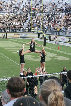UCF Cheerleading 2007. Crystal and I holding Allie.