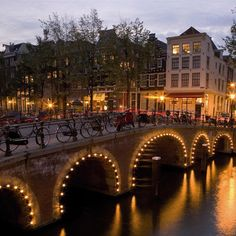 Amsterdam bridges at night. Find this and more of the best city breaks in Europe at Redonline.co.uk