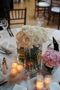 The centerpieces were all slightly different but romantic full roses were at every table.