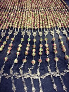 New rosary arrivals ahead of the Month of the Holy Rosary in October. We think this one will be a customer favorite with its multi-faceted glass beads, pink swirl roses, green leaves, and gold flecks.