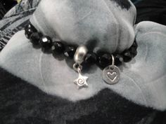 Stretch faceted Onyx gemstone bracelet with silver heart charm by InnerGems on Etsy