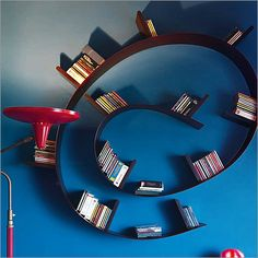 SERIOUSLY AWESOME bookshelf.  I wonder if we could get Jeff to make us something similar?