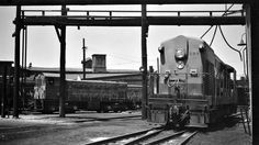 NH, Boston, Massachusetts, 1950-1955 New York, New Haven and Hartford train with FM H-44 switcher no. 599 and Alco S-2 at Dover Street, in…