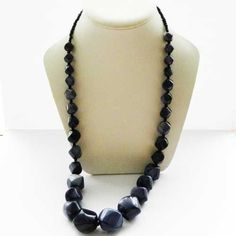 Modern long and chunky dark purple bead necklace Large shaped beads with multi-tonal coloring that graduate in size Small black seed beads at neck