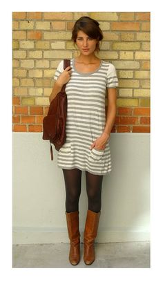 dress with pockets. tights. knee-high boots. casual elegance.