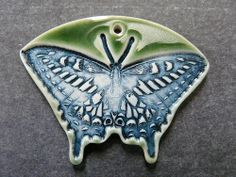 Porcelain butterfly pendant by Round Rabbit
