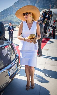 Queen Maxima of the Netherlands donned her signature oversized hat and some cool oversized shades for her arrival at the airport in Palermo during day two of her visit to Italy.<br><p>Photo: Patrick van Katwijk/Getty Images