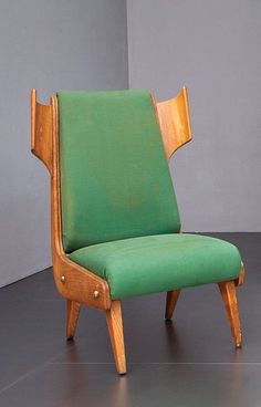 Anonymous; Oak and Brass Easy Chair Attributed to Pozzi e Verga, 1950s.