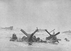 US troops taking cover behind German beach obstacles, Normandy, 6 Jun 1944. Robert Capa