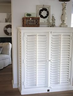 beautiful idea for using vintage shutters...