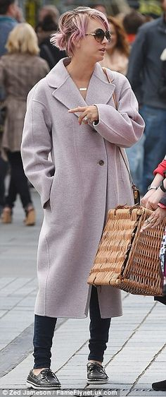 Casual: Despite her low-key appearance Kaley was on-trend in a midi-length coat that appeared to match her hair, while skinny jeans and loafers rounded things off