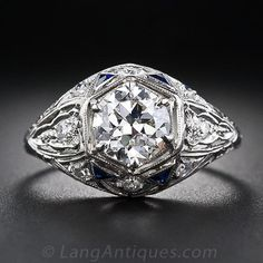 This dazzling and dynamic, original Art Deco engagement ring - circa 1930 - features a beautiful, bright and sparkling European-cut diamond ...