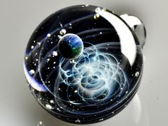 Galaxies Sculpted in Space Glass Globes. Come and see how they are made. To see more art and information about Satoshi Tomizu click the image.