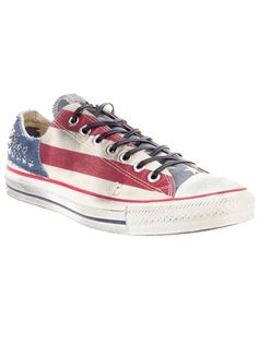 Nude cotton 'All Star' sneaker from Converse All Star featuring a round toe, a top lace up fastening, a contrasting red and blue stars and stripes print design throughout, silver-tone star studs at the heel and an aged white rubber sole.