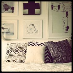 layered black and white patterned pillows, interesting prints