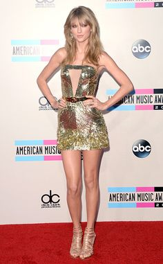Golden girl! Taylor Swift looks fab in this Julien MacDonald mini. #fashion