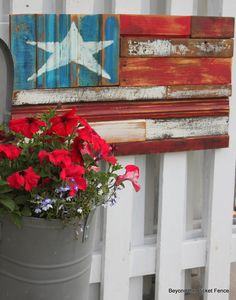 Bucket of petunias and a wooden flag