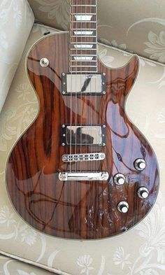 This Les Paul style guitar features a rosewood top. It has Seymour Duncan Active pickups and I found it on their Facebook page.