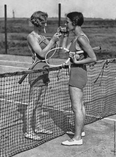 Two 1920s tennis players (playing in what appears to be swim or rowing suits) stop for a smoke break between serves. Description from pinterest.com. I searched for this on bing.com/images