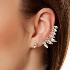 """T&j Designs Crystal Studs and Wing Cuff. 4 left Just in! These gorgeous earrings are from the T+j Designs Collection which launched in the Poshmark Wholesale Portal! 15% off bundles of 2+ items! Let me know if you have any questions/if you are interested in purchasing! Today only ask me about .99 shipping!  Crystal wing ear cuff and stud set! Wear each piece on it's own or pair the two together for an ultra glam look!  1 cuff and 2 studs included Cuff: 2"""" x .5"""" Studs: .375"""" in diameter Cuff…"""