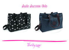 The Suite Success Tote is sized to fit your laptop, plus it has a thermal lining to hold all your snacks or beverages. LOVE!!!