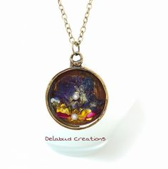 Real flowers grown in my own garden here in Ireland, dried over a few weeks and encased in resin to last forever. Nestled in an antique bronze colored round deep pendant. Wearing Nature close to your Heart. Created in my studio in Cork City, Ireland. Growing Flowers, Real Flowers, Resin Pendant, Pendant Necklace, Cork City, Irish Design, Polymer Clay Jewelry, Ireland, Jewelery