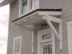 love the brackets and little side entrance overhang.