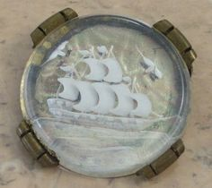 Reverse carved antique brooch set into a brass back. Sailing ship.