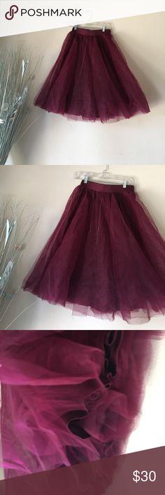 A burgundy tulle midi skirt A burgundy tulle midi skirt Windsor Skirts Midi