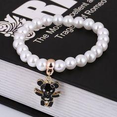 Elegant White Bracelet With Golden Bear Charm