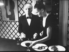 Ballet Master George Balanchine and Ballerina Karen Von Aroldinger Eating During Party