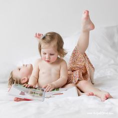 The reader and the day dreamer. #lifestylekidsphotographer #commercialkidsphotographer #sisters