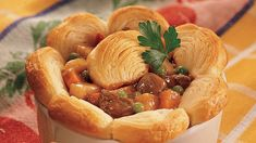 Dinner ready in less than one hour! Enjoy this beef steak and veggies pot pie baked using Pillsbury® Refrigerated Crescent Dinner Rolls and Frozen Sweet Peas.