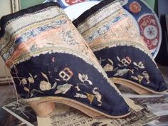 "Antique Chinese shoes for a woman's broken & bound feet, euphemistically named ""lotus feet""--cruel objects of desire for Chinese men, hopefully no longer the case."