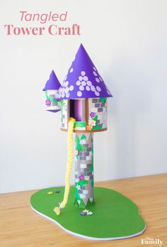 """Looking for a fun way to spend a rainy day when you're trapped in your house like Rapunzel? This easy-to-make """"Tangled"""" Tower Craft is perfect for crafting with your kiddos and creating memories they'll never forget. Disney Princess Crafts, Disney Crafts For Kids, Disney Diy, Toddler Crafts, Preschool Crafts, Diy For Kids, Disney Tangled, Toilet Paper Crafts, Paper Roll Crafts"""