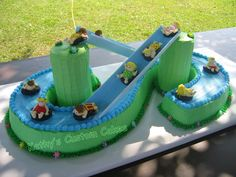 Water Slide - From a Wilton design.  All buttercream.  Towers are cookies covered in royal.  Kids, tubes and flowers are royal.  Slides are flower formers.