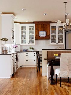This newly remodeled kitchen features a mix of wood and white cabinets. I really like the addition of some brown wood mixed w/ the white cabinets. Warms this kitchen up. Kitchen Redo, New Kitchen, Kitchen Remodel, Kitchen Design, Kitchen Renovations, Kitchen Makeovers, Kitchen Island, Kitchen Ideas, Kitchen Pics