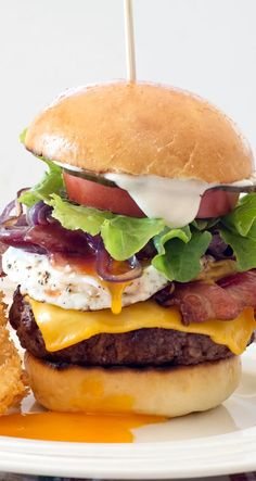 Aussie Burger ~ Loaded! With my favorite kind of hamburger bun. Mmm... | summer party recipe