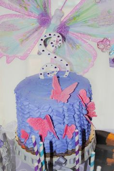 Beautiful lavender cake at a Butterfly party!  See more party ideas at CatchMyParty.com!  #partyideas #butterfly