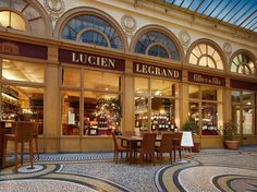 A precursor to the modern shopping mall, the city's 19th century covered passageways are almost impossible atmospheric. Topped with a glass roof to protect from bad weather, these arcades are lined with shops and cafes that open onto a mosaic-tiled walkway. In the Galerie Vivienne, which was built in 1823, you'll find an excellent wine shop called Legrand Filles et Fils. Opened in 1880, Legrand also offers an old-fashioned gourmet épicerie that's straight out of the Old World. Enjoy a…