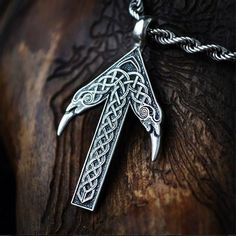 This is the rune of the Norse god, Tyr.  It is tiwaz