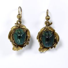 Jewel beetles weren't the only beetles to find their way in to fashion. These earrings were made in England with real tortoise beetles circa 1850.