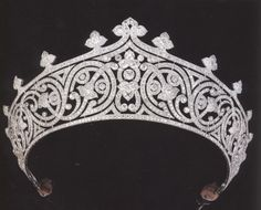 Thought to have been made around 1910 by a leading French jeweller (possibly Chaumet or Cartier) it is pierced and millegrain-set with circular-cut diamonds in a design of meandering scroll and trefoil motifs. Set in platinum, the tiara has a distinctly modern feel - its fluid symmetry setting it apart from the more formal designs associated with heavier and earlier pieces set in silver and gold.
