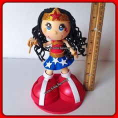 Inspired in Wonder Woman in Fofucha Doll. Perfect centerpiece or cake topper for any birthday party. 100% handmade. See more at www.facebook.com/FofuchasHandmadeDolls #WonderWoman #SuperHeros #birthdaycenterpiece #caketopper
