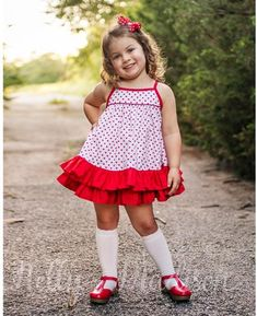 High volume ruffled hem dress with adjustable shoulder ties Dress is fully lined Red polka...