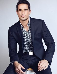 Navy suit with casual print shirt; nice combo