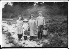 Three pickers going home from work. Anne, 7 years old, and brother Vincent said 11. Vincent picked last summer. Inez, sister said 6 years old, and picked last summer wid me mudder. Smallest one not quite large enough to get work. Father works in Parker Mills. Parker Mills, Mass, September 1911