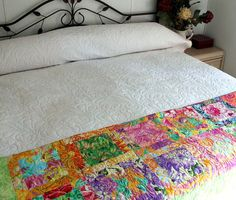 Quilt ON SALE!!!!! Such a gorgeous, bright and cheerful Quilt. Made with a wonderful floral collection of Phillip Jacobs Prints, perhaps with a Kaffe Fassett print here or there...bright, vivacious, unique. Designed to brighten your day. Relax, cover up, close your eyes, run your fingers over the hills and valleys created by the beautiful quilting stitches and smell the sweet aroma of Omas Garden, you will love it!    Backed with a geometric design print from Amy Butlers Midwest Modern…